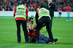 ADELAIDE, AUSTRALIA - Monday, July 20, 2015: Security tackle a supporter who ran onto the pitch after Liverpool's 2-0 victory over Adelaide United during a preseason friendly match at the Adelaide Oval on day eight of the club's preseason tour. (Pic by David Rawcliffe/Propaganda)