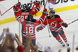May 25, 2012; Newark, NJ, USA; The New Jersey Devils celebrate a goal by New Jersey Devils center Ryan Carter (20) during the first period in game six of the 2012 Eastern Conference finals at the Prudential Center.