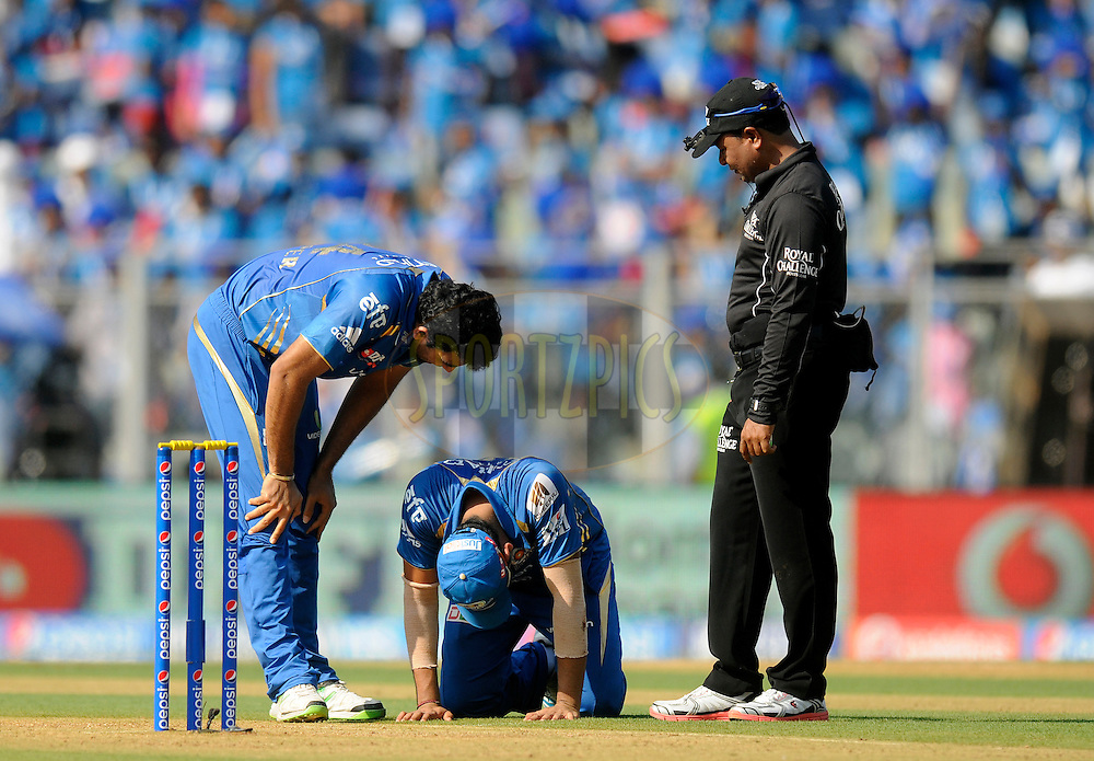 Zaheer Khan of the Mumbai Indians checks on teammate Rohit Sharma captain of of the Mumbai Indians as the latter gets injured during match 22 of the Pepsi Indian Premier League Season 2014 between the Mumbai Indians and the Kings XI Punjab held at the Wankhede Cricket Stadium, Mumbai, India on the 3rd May  2014<br /> <br /> Photo by Pal Pillai / IPL / SPORTZPICS<br /> <br /> <br /> <br /> Image use subject to terms and conditions which can be found here:  http://sportzpics.photoshelter.com/gallery/Pepsi-IPL-Image-terms-and-conditions/G00004VW1IVJ.gB0/C0000TScjhBM6ikg