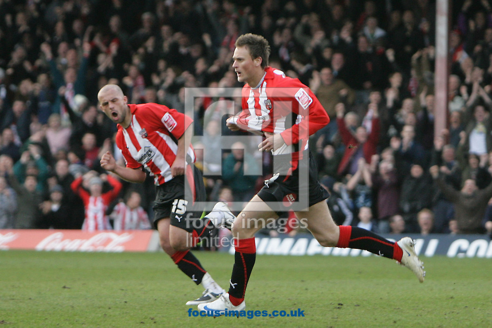 London - Saturday, March 14th, 2009: Sam Williams (R) of Brentford celebrates scoring his side's third goal with team mate David Hunt during the Coca Cola League Two match at Griffin Park, London. (Pic by Mark Chapman/Focus Images)