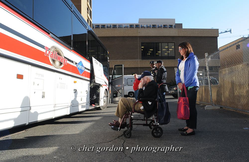 WWII Veterans and their escorts onboard the Hudson Valley Honor Flight at the Doubletree Hotel in Arlington, VA on Saturday, April 11, 2015. Nearly 100 Veterans from the Orange County (NY) region toured the WWII, Korean, Vietnam, and USMC War Memorials, as well as Arlington National Cemetery. Hudson Valley Honor Flight is a chapter of the Honor Flight Network, which provides free flights for WWII Veterans and tours of the WWII Memorial constructed in their honor, and other sites in the nation's capital.  © Chet Gordon for Hudson Valley Honor Flight
