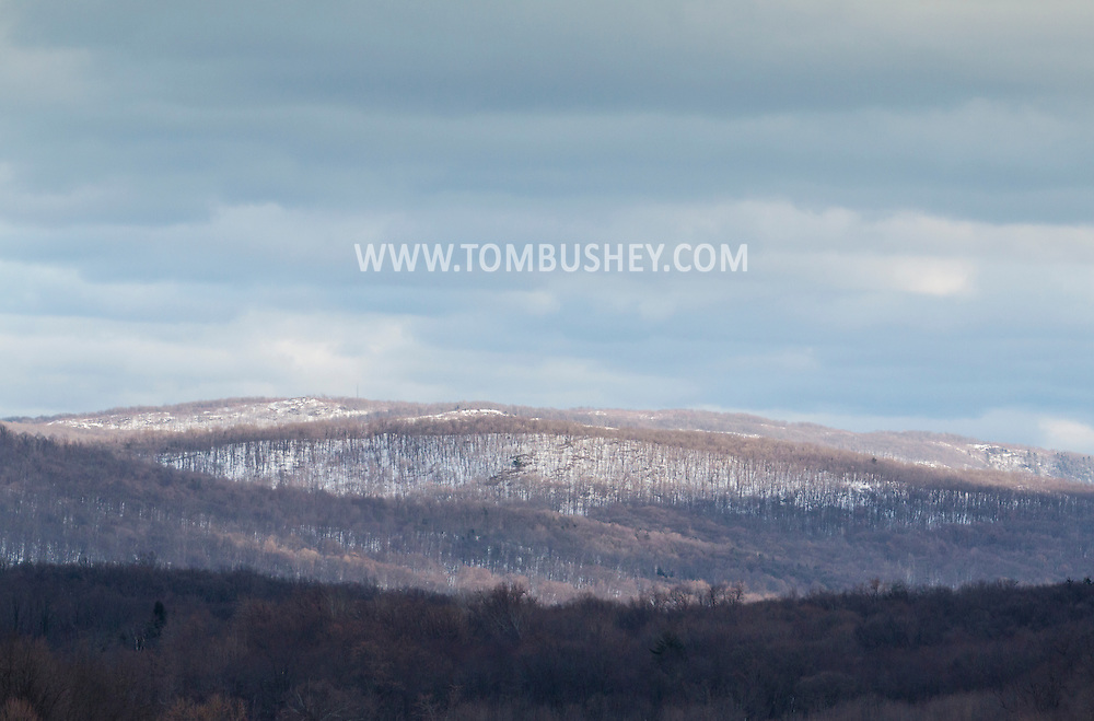 Cornwall, New York - Sunlight and shadows move across the Hudson Highlands on March 15, 2015.