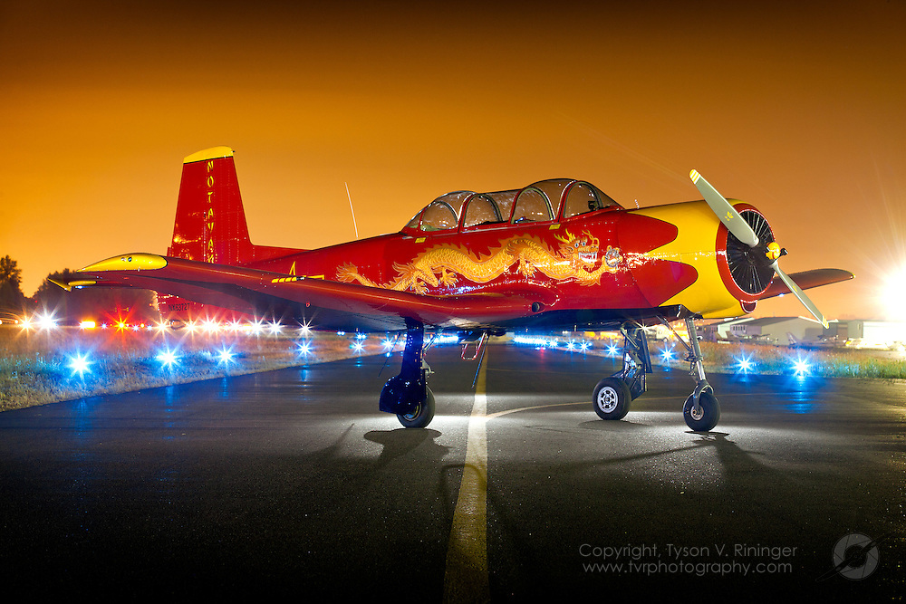 Tom Elliott's CJ-6A Nanchang 'Notayak' is positioned on a taxiway at Aurora Airport near Portland, Oregon for a nighttime photo session.