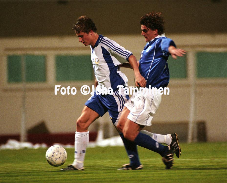 06.10.2000, Kesariani Stadium, Athens, Greece. UEFA under-21 European Championship qualifying match, Greece v Finland. .Paulus Roiha (Finland) v Louboutis (Greece).©JUHA TAMMINEN