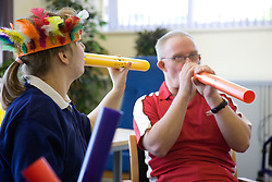 Day Service users with learning disability taking part in a music session,