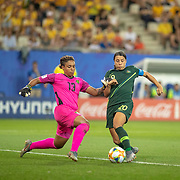 GRENOBLE, FRANCE June 18. Sam Kerr #20 of Australia pounces on an error from goalkeeper Nicole McClure #13 of Jamaica to score her fourth goal during the Jamaica V Australia, Group C match at the FIFA Women's World Cup at Stade des Alpes on June 18th 2019 in Grenoble, France. (Photo by Tim Clayton/Corbis via Getty Images)