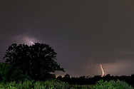 Middletown, New York - Lightning strikes in the distance behind farm fields during a thunderstorm on the night of Aug. 9, 2012.