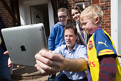 © Licensed to London News Pictures. 04/05/2015. Sutton, UK. Deputy Prime Minister, Nick Clegg takes a selfie on an iPad with young supporters in Sutton. Photo credit : Vickie Flores/LNP