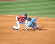 Ole Miss' Preston Overbey (1) vs. Rhode Island Joe Landi (8) is caught stealing at Oxford-University Stadium in Oxford, Miss. on Sunday, February 24, 2013. Ole Miss won 5-3 to improve to 7-0.