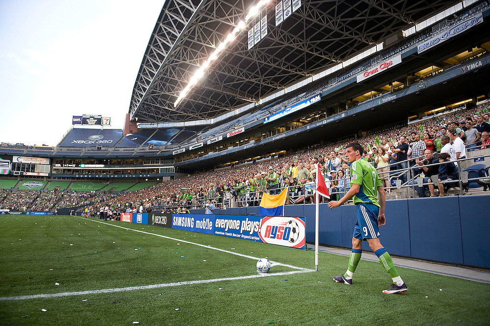 SEATTLE - JUNE 13:  Sebastien LeToux, #9 of the Seattle Sounders FC prepares to take a corner kick against the San Jose Earthquakes at Qwest Field on June 13, 2009 in Seattle, Washington.  (Photo by Rod Mar/MLS via Getty Images)