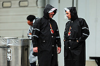 (L to R): Jason Swales (GBR) NBC Sports Network and Will Buxton (GBR) NBS Sports Network TV Presenter in a wet and rainy paddock.<br /> Japanese Grand Prix, Sunday 5th October 2014. Suzuka, Japan.
