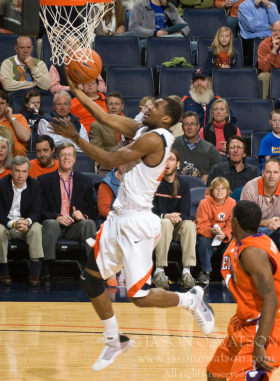 Virginia guard Jeff Jones (23) finishes a layup against Clemson.  The Virginia Cavaliers defeated the #12 ranked Clemson Tigers in overtime 85-81 at the John Paul Jones Arena on the Grounds of the University of Virginia in Charlottesville, VA on February 15, 2009.