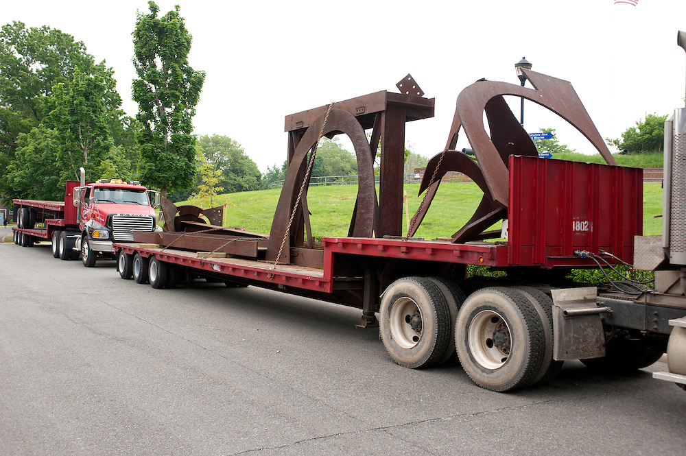 Flatbed trucks transport the art to the sites on Governors Island..Sculptures by Mark di Suvero at Governors Island, New York, presented by Storm King Art Center. The show opens Friday May 27th - Sunday, September 25, 2011..The exhibition is the largest outdoor presentation of Mark di Suvero's sculptures to be shown in New York City since the 1970s and includes loans from public and private collection