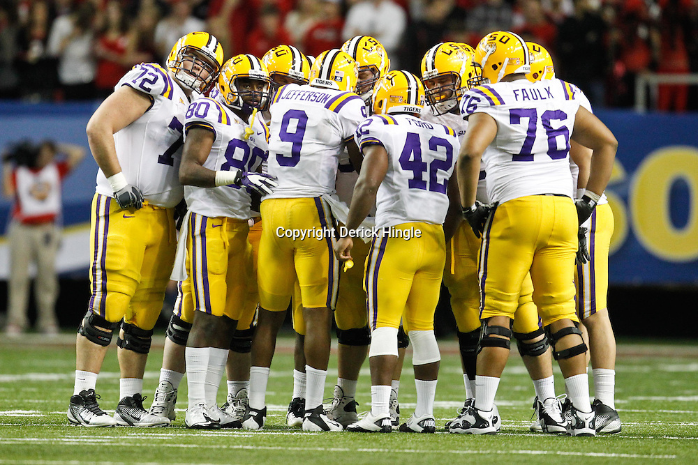 Dec 3, 2011; Atlanta, GA, USA; LSU Tigers quarterback Jordan Jefferson (9) in the huddle against the Georgia Bulldogs during the second half of the 2011 SEC championship game at the Georgia Dome.  Mandatory Credit: Derick E. Hingle-US PRESSWIRE