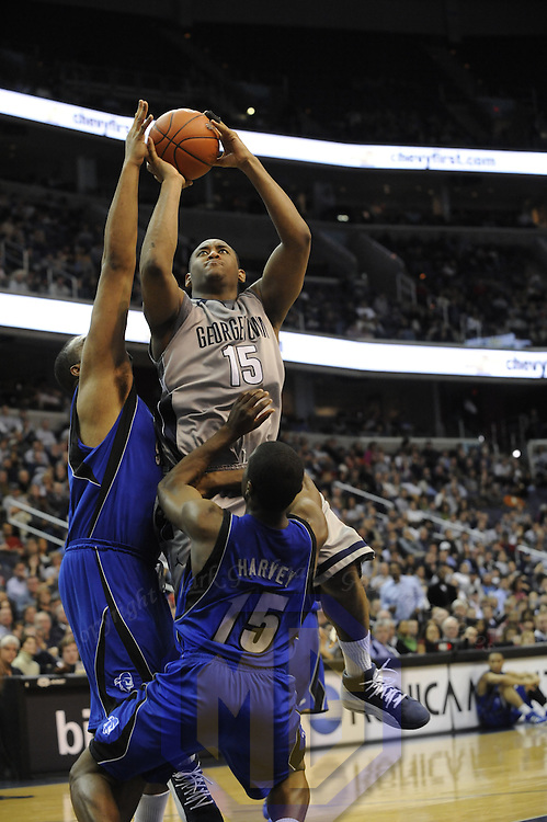 02 February 2008:   Georgetown University Hoyas guard Austin Freeman (15) is fouled by Seton Hall Pirates guard Eugene Harvey (15) at the Verizon Center in Washington, D.C.  The Hoyas defeated the Seton Hall Pirates 73-61.