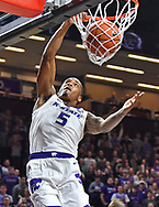 MANHATTAN, KS - JANUARY 09:  Barry Brown Jr. #5 of the Kansas State Wildcats scores on a brake away dunk against the West Virginia Mountaineers during the second half on January 9, 2019 at Bramlage Coliseum in Manhattan, Kansas.  (Photo by Peter G. Aiken/Getty Images) *** Local Caption *** Barry Brown Jr.