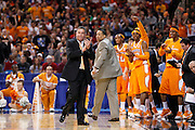 ST. LOUIS, MO - MARCH 26: Head coach Bruce Pearl of the Tennessee Volunteers applauds after a basket by his team against the Ohio State Buckeyes during the Midwest regional semi-final of the NCAA men's basketball tournament at the Edward Jones Dome on March 26, 2010 in St. Louis, Missouri. Tennessee advanced with a 76-73 win. (Photo by Joe Robbins)