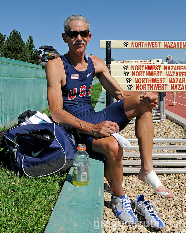 Hal Tacker takes a break during the Idaho Senior Games Track and Field Meet held at the Northwest Nazarene University in Nampa, Idaho on August 21, 2010.<br /> <br /> Despite competing on an broken foot, Tacker managed to win 2 golds (200m, 400m), a silver (50m) and 3 bronze (100m, 800m, 1500m) in the 55-59 age group.
