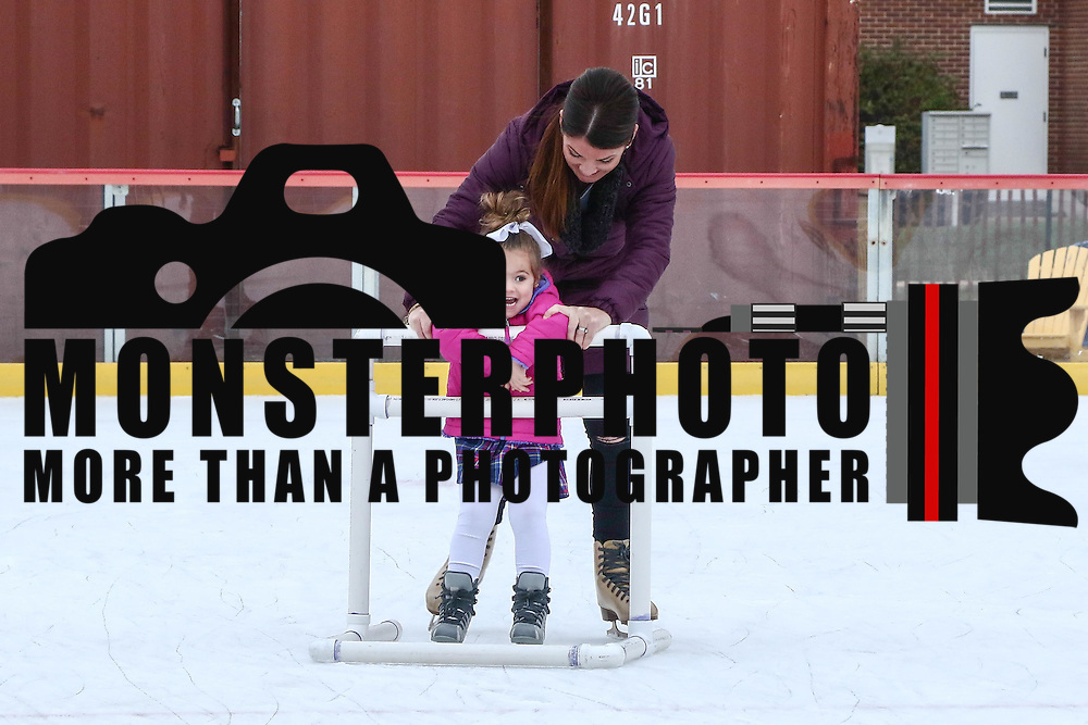 Skaters Giada Indica (3) and her mother Dena Indica glide across the ice Friday. Nov. 25, 2016, at the Horizon Services Riverfront Rink at ConstitutionYard Beer Garden in Wilmington.
