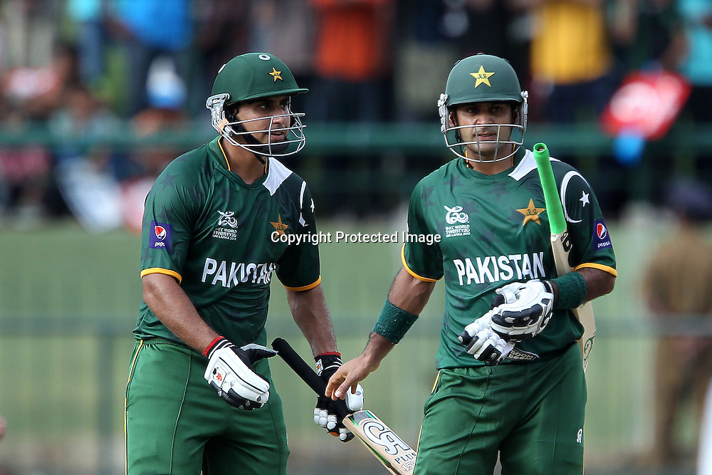 Nasir Jamshed and Mohammad Hafeez during the ICC World Twenty20 Pool match between Pakistan and New Zealand held at the  Pallekele Stadium in Kandy, Sri Lanka on the 23rd September 2012<br /> <br /> Photo by Ron Gaunt/SPORTZPICS/PHOTOSPORT