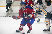 Fairport's Tyler Sullivan chases a puck in the offensive zone during a scrimmage against Victor at Thomas Creek in Fairport on Monday, November 24, 2014.
