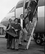 Red Hurley/Bendan Graham- Eurovision Song Contest 30/03/1976  Red Hurley/Brendan Graham- Eurovision Song Contest .30/03/1976.03/30/1976.30th March 1976.Red Hurley and Brendan Graham leave for the Eurovision song contest in The Hague, Netherlands   Photograph of the singer Red Hurley and his manager, Tommy Hayden, composer Brendan J. Graham and Noel Keleghan, conductor leaving Dublin Airport this morning, 30.03.1976, for the Eurovision Song Contest in The Hague, Netherlands
