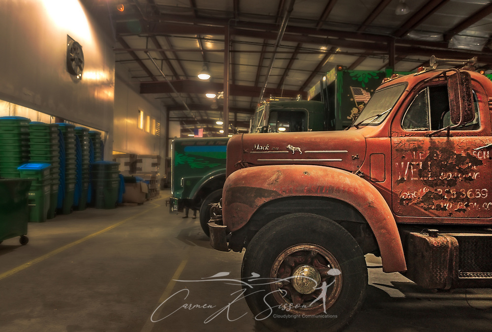 "An antique Mack Truck is pictured at Waste Pro, March 18, 2016, in Sanford, Florida. The company has a garbage truck museum on the premises and restores antique garbage trucks. Waste Pro offers waste and recycling services to more than two million residential customers and more than 40,000 businesses in Alabama, Florida, Georgia, South and North Carolina, Louisiana, Mississippi, and Tennessee. The company has committed to ""going green"" by implementing a number of green initiatives, including using CNG (Clean Natural Gas) in its trucks, recycling more waste instead of sending it to landfills, and powering its regional headquarters throuh solar energy. (Photo by Carmen K. Sisson/Cloudybright)"