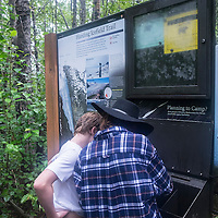 Zane (L) and Blaze Menendez from Orlando, Florida overlook the map of the Harding Icefield trail at the Kenai Fjords National Park in Seward, Alaska, on Thursday, August 4, 2016. (Alex Menendez via AP)