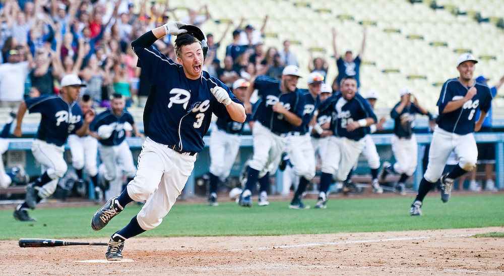 Pacifica's Daniel Ferrell steps on home plate with the winning run as he and the rest of the team celebrate their victory over Aliso Niguel in Friday's CIF championship game at Dodger Stadium.