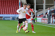 Crewe Alexandra defender Oliver Turton holds off Walsall striker Milan Lalkovic during the Sky Bet League 1 match between Walsall and Crewe Alexandra at the Banks's Stadium, Walsall, England on 26 September 2015. Photo by Alan Franklin.