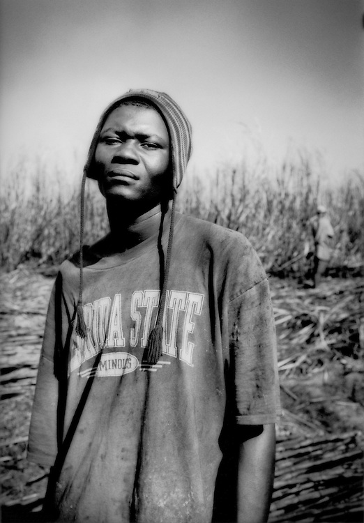 "Yaenqle Cirve (""Ya-en-klei Sir-ve""), Haitian sugar cane cutter in fields near Barahona, Domincan Republic."