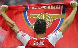 Arsenal's Olivier Giroud lifts an Arsenal Flag - Photo mandatory by-line: Joe Meredith/JMP - Mobile: 07966 386802 10/08/2014 - SPORT - FOOTBALL - London - Wembley Stadium - Arsenal v Manchester City - FA Community Shield