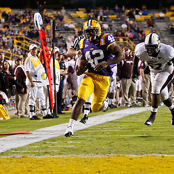 November 13, 2010; Baton Rouge, LA, USA;  LSU Tigers running back Michael Ford (42) runs past Louisiana Monroe Warhawks defensive end Ken Dorsey (52) for a touchdown against the Louisiana Monroe Warhawks during the second half at Tiger Stadium. LSU defeated Louisiana-Monroe 51-0.  Mandatory Credit: Derick E. Hingle