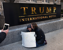 "December 10, 2016 - Washington, DC, USA - SHAWNA BADER-BLAU from DC kisses her son JAMES BLAU, 8 years old, in front of Trump hotel sign.  Children's Rally for Kindness takes place at Trump International Hotel in Washington DC on December 10, 2016 organized by the Takoma Parents Action Coalition.  According to their FaceBook page, it was a call to President-elect Donald Trump: ''to remember these lessons as he prepares to take office and implement policies that will affect the lives of children and families across our diverse nation.''.''All over the world, across cultures and countries, children learn the same basic lessons: .Ã'be kind,Ã"" .Ã'tell the truth,Ã"" .Ã'be fair,Ã"" .Ã'respect everyone,Ã"" .Ã'treat others the way you want to be treated,Ã"" .Ã'donÃ•t touch others if they donÃ•t want to be touched. (Credit Image: © Carol Guzy via ZUMA Wire)"