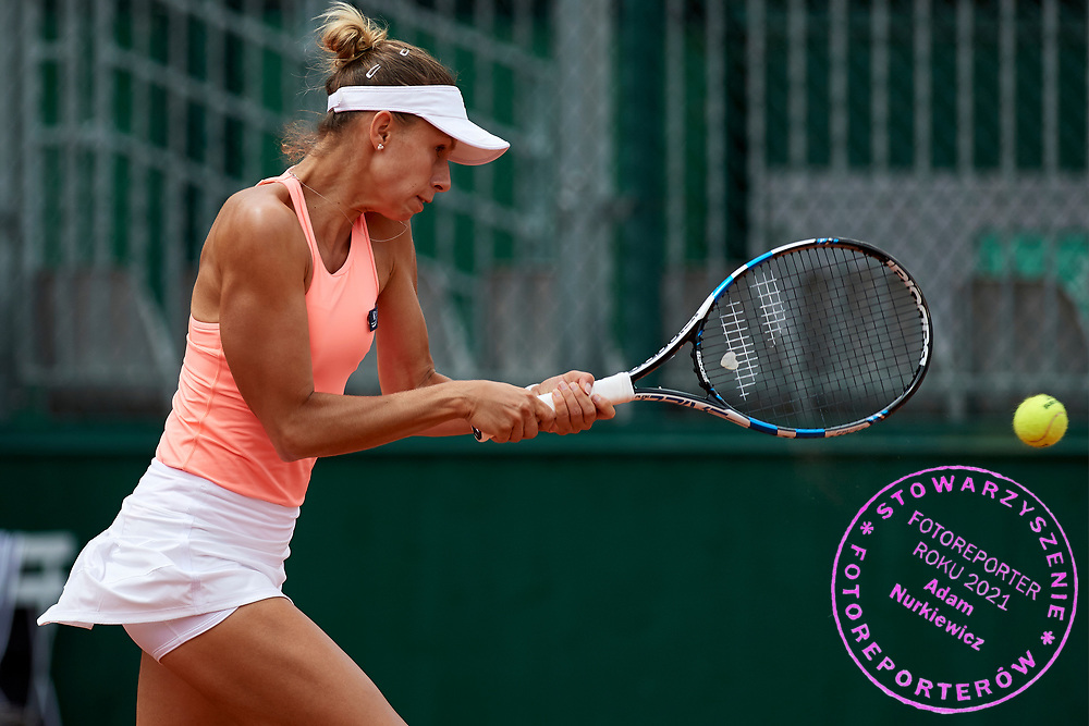 Paris, France - 2017 June 02: Magda Linette from Poland plays a backhand while her women's double match second round during tennis Grand Slam tournament The French Open 2017 (also called Roland Garros) at Stade Roland Garros on June 02, 2017 in Paris, France.<br /> <br /> Mandatory credit:<br /> Photo by &copy; Adam Nurkiewicz<br /> <br /> Adam Nurkiewicz declares that he has no rights to the image of people at the photographs of his authorship.<br /> <br /> Picture also available in RAW (NEF) or TIFF format on special request.<br /> <br /> Any editorial, commercial or promotional use requires written permission from the author of image.