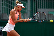 Paris, France - 2017 June 02: Magda Linette from Poland plays a backhand while her women's double match second round during tennis Grand Slam tournament The French Open 2017 (also called Roland Garros) at Stade Roland Garros on June 02, 2017 in Paris, France.<br /> <br /> Mandatory credit:<br /> Photo by © Adam Nurkiewicz<br /> <br /> Adam Nurkiewicz declares that he has no rights to the image of people at the photographs of his authorship.<br /> <br /> Picture also available in RAW (NEF) or TIFF format on special request.<br /> <br /> Any editorial, commercial or promotional use requires written permission from the author of image.
