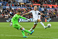 Football - 2019 / 2020 Sky Bet (EFL) Championship - Swansea City vs. Reading<br /> <br /> Rafael Cabral of Reading clears despite the efforts of Sam Surridge of Swansea in the final seconds of the match , at the Liberty Stadium.<br /> <br /> COLORSPORT/WINSTON BYNORTH