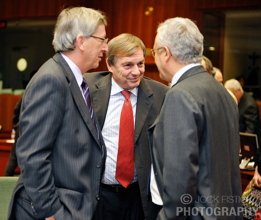 Jean-Claude Juncker, Luxembourg's prime minister and president of the Euro Group, left, Jeannot Krecke, Luxembourg's minister of economy and foreign trade, center, and Giulio Tremonti, Italy's Finance minister, speak before the start of the the meeting of European Union economic and finance ministers (ECOFIN) at the European Council headquarters, in Brussels, Belgium, Tuesday, Nov. 4, 2008. (Photo © Jock Fistick)