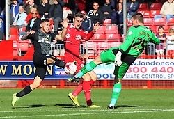 Peterborough United's Jon Taylor challenges Crawley's Jamie Ashdown and Sonny Bradley - Photo mandatory by-line: Joe Dent/JMP - Mobile: 07966 386802 - 11/10/2014 - SPORT - Football - Crawley - Checkatrade.com Stadium - Crawley Town v Peterborough United - Sky Bet League One