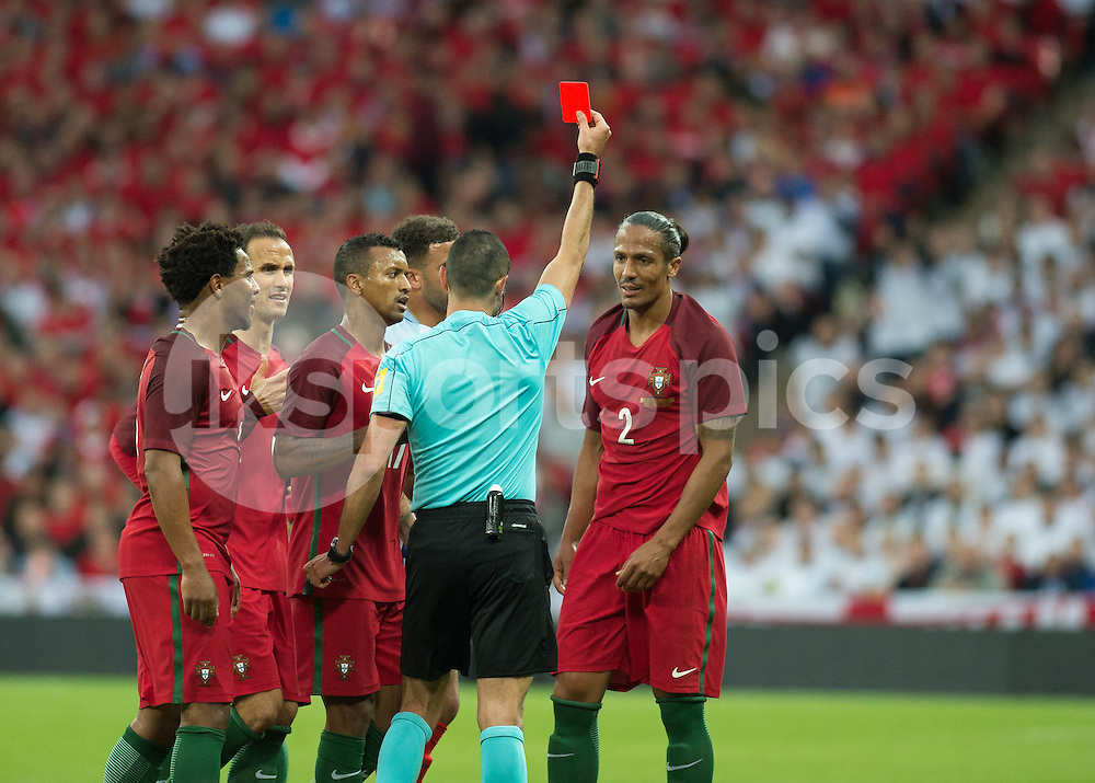 Bruno Alves of Portugal is shown the red card by Referee Marco Guida (Italy) during the International Friendly match between England and Portugal at Wembley Stadium, London, England on 2 June 2016. Photo by Vince  Mignott.