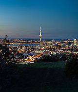 Auckland city at dusk, taken from Mt Eden. New Zealand two images stitched together, file size 3640 x 4288 pixels, Crop ro suit application.