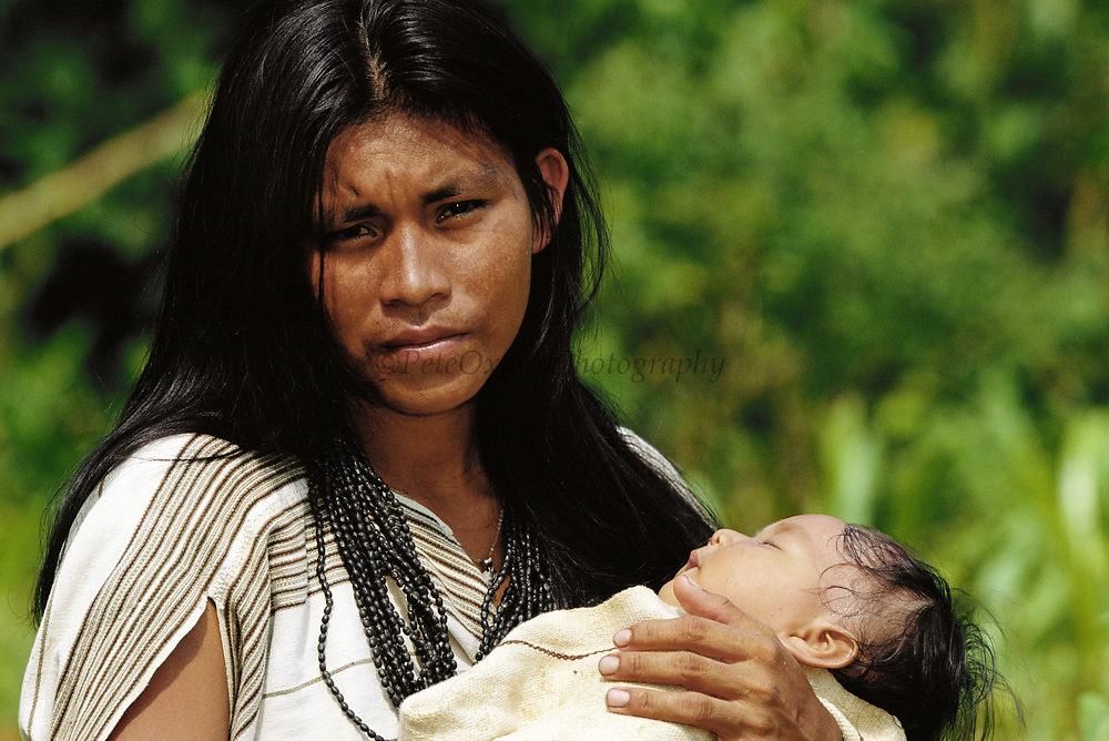 Machiguenga Indian with Baby<br />Timpia Community<br />Lower Urubamba River.  Amazon.  PERU  South America