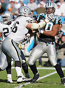 CHARLOTTE, NC - NOVEMBER 7:  Defensive end Julius Peppers #90 of the Carolina Panthers gets stopped by rookie tackle Robert Gallery #76 of the Oakland Raiders at Bank of America Stadium on November 7, 2004 in Charlotte, North Carolina. The Raiders defeated the Panthers 27-24. ©Paul Anthony Spinelli  *** Local Caption *** Julius Peppers;Robert Gallery