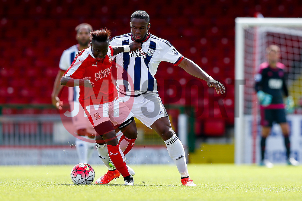 Drissa Traore of Swindon Town is challenged by Victor Anichebe of West Brom - Mandatory byline: Rogan Thomson/JMP - 07966 386802 - 25/07/2015 - SPORT - Football - Swindon, England - The County Ground - Swindon Town v West Bromwich Albion - 2015/16 Pre Season Friendly.
