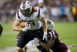 South Carolina tight end Hayden Hurst (81) is brought down by Texas A&M defensive back Armani Watts (23) for s short gain during the second quarter of an NCAA college football game Saturday, Sept. 30, 2017, in College Station, Texas. (AP Photo/Sam Craft)