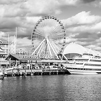 Panoramic Navy Pier black and white picture in Chicago with the Ferris Wheel and tour boats along Lake Michigan. Panorama ratio is 1:3. Image Copyright © Paul Velgos All Rights Reserved.