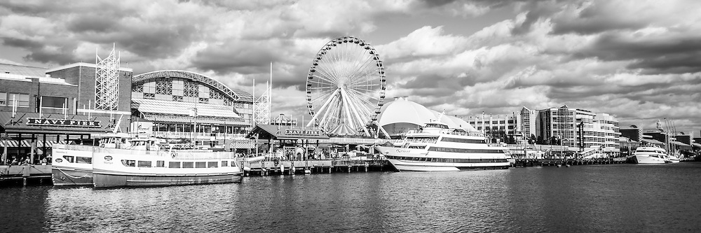 Panoramic navy pier black and white picture in chicago with the ferris wheel and tour boats