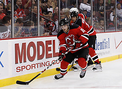 Oct 3, 2009; Newark, NJ, USA; New Jersey Devils right wing Matt Halischuk (16) skates with the puck during the second period at the Prudential Center.