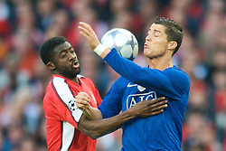 LONDON, ENGLAND - Tuesday, May 5, 2009: Arsenal's Kolo Toure and Manchester United's Cristiano Ronaldo during the UEFA Champions League Semi-Final 2nd Leg match at the Emirates Stadium. (Photo by David Rawcliffe/Propaganda)