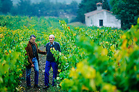 Etienne and Jacques Montes Walking Through Vineyard